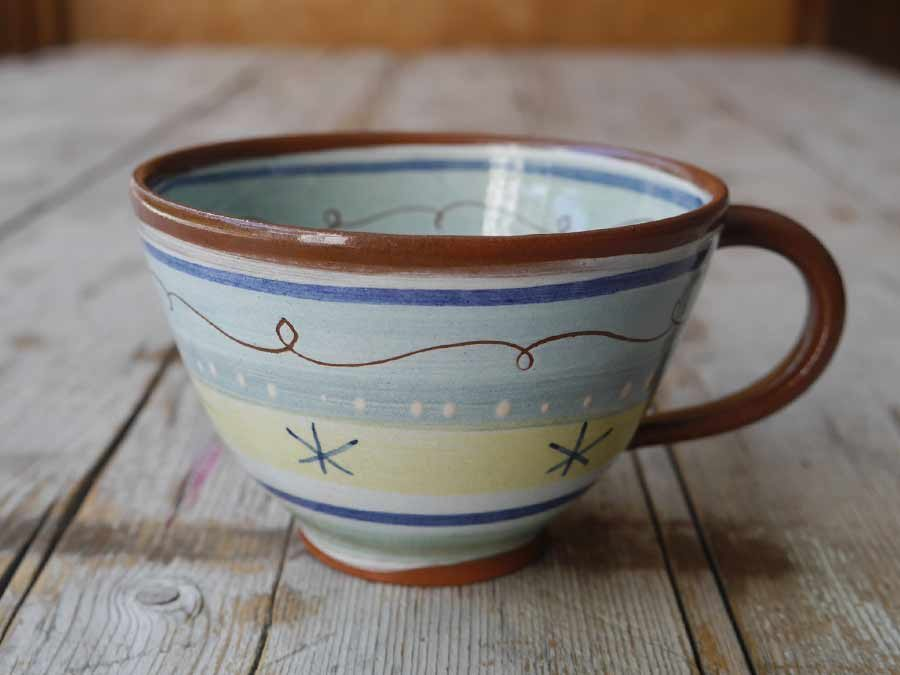 Slip decorated cup