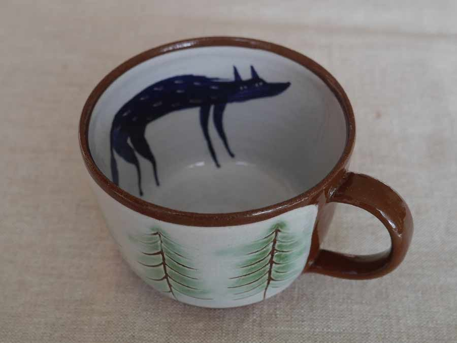 Wolf in pine forest cup