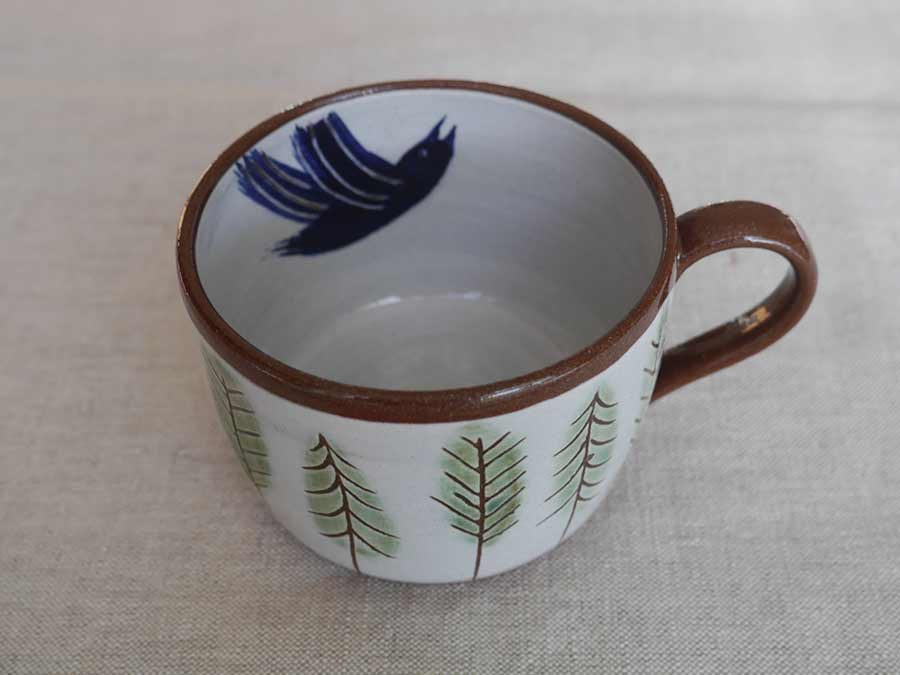 Bird in pine forest cup